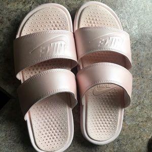 Women's size 9 rose Nike slides